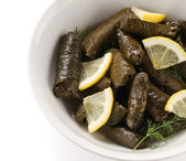 Dolma, stuffed grape leaves in a bowl — Stock Photo