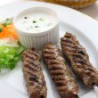 Stock Photo: Ground lamb kebab with flat bread