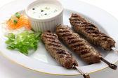 Ground lamb kebab on white background — Stock Photo