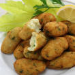 Salt cod (bacalhau,bacalao) fritters, croquettes — Stock Photo #33886937