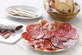 Various types of  spanish salami, sausage and ham. — Stok fotoğraf