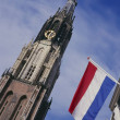 New church and flags at the market place, Delft — Stock Photo