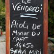 Outside menu sign for aioli — Stock Photo