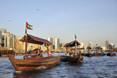 View of Deira quarter from Dubai creek with abra or water taxi — Stock Photo