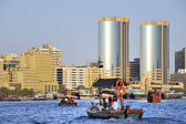 View of Dubai creek with abras or water taxis at foreground — Stok fotoğraf