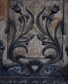 Old decorated wooden door — Stock Photo