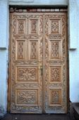 Decorated wooden door — Stock Photo