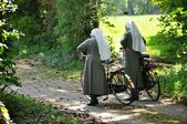 Nuns with bicycles — Stock Photo