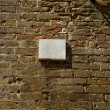 Blank plaque on a brick wall surface. — Stock Photo