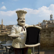Stock Photo: Italichef with Sienpanoramic view on his back. Siena, Italy