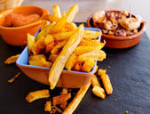 Typical spanish tapas. Fries, croquettes and squid tapas — Stock Photo