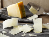 Parmesan cheese slices. — Stock Photo
