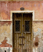 Antique door in a house with worn stone wall texture. — Stock Photo