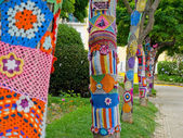 Yarn bombing in trees. European park. — Stock Photo