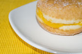 Doughnut in yellow background — Stock Photo