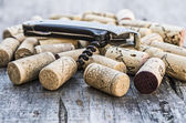 Corks with corkscrew — Stock Photo