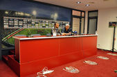 Football coach at press conference — Stock Photo