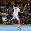 Stock Photo: Tennis player Frederik Nielsen in action at Davis Cup match, Romanibeats Denmark with 3:0