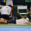 Stock Photo: Tennis mAdriUngur suffered accident during match in Davis cup