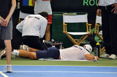 Tennis man Adrian Ungur suffered an accident during the match in Davis cup — Stock Photo