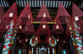 Hanging incense coils in a Vietnamese pagoda, Hoi An, Vietnam — Stock Photo