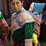 Постер, плакат: Hmong woman carrying her child in Bac Ha Vietnam