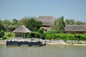 Traditional houses with thatched roof in the Danube delta, Romania — Stock Photo