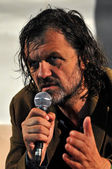 Emir Kusturica movie director and musician from Serbia answering questions during the press conference after his live concert — Stock Photo