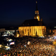 Ten thousands of people, crowd in the main city square at evening, during a live concert — Stock Photo