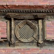 Carved wooden window with extraordinary details on the Royal Palace. Durbar square, Patan, Kathmandu, Nepal — Stock Photo