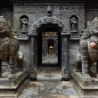 Stock Photo: Stone lion statues near entrance of Golden Temple (KwBahal) on Durbar square. Patan, Kathmandu, Nepal