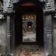 Stock Photo: Entrance to Buddhist Golden Temple (KwBahal) on Durbar square. Patan, Kathmandu, Nepal