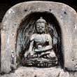 Ancient bas relief statuette of sitting Buddha in Swayambhunath. Kathmandu, Nepal — Stock Photo #33811541