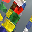 Buddhist Tibetan prayer flags blowing in the wind — Стоковая фотография