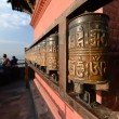 Buddhist prayer wheels in Swayambhunath, Nepal — Stock Photo #34791659