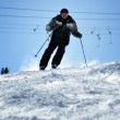 Skier skiing down the slope in a beautiful sunny day — Stock Photo