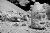 Black and white photo of head statue from Nemrut mountain. Turkey — Stock Photo