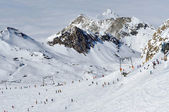 Snowy mountain landscape in sunny weather with ski piste — Stock Photo