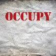 Stock Photo: Red Occupy letters on grunge paper background