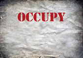 Red Occupy letters on a grunge paper background — Stock Photo