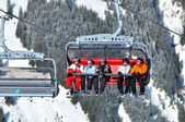Skiers going up with a ski lift in the Alps — Stock Photo