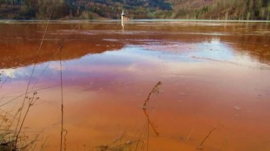 Copper mining residuals in a lake. Ecological catastrophe in Geamana, Romania — Stock Video