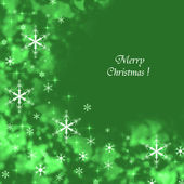 Green Merry Christmas background with snowflakes — Stock Photo