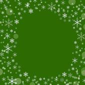 Kerstmis groene achtergrond met sneeuwvlokken, ruimte voor tekst — Stockfoto