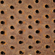 Rusty iron background with holes — Stock Photo