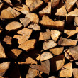 Background of stacked chopped wood prepared for winter — ストック写真