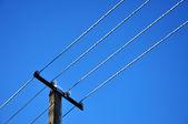 Power pylon cable under blue sky — Stock Photo