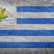 Stock Photo: Grunge flag of Uruguay with cannabis leaf. Uruguay becomes first country to legalize marijuantrade
