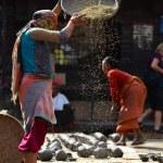 Woman threshing grain in Kathmandu, Nepal — Stock Photo #37374173
