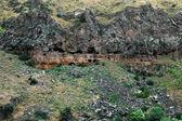 Cave entrances in Ashtarak canyon, Caucasus mountains, Armenia — Stock Photo